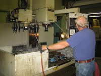 one of the guys on one of our smaller CNC milling machines